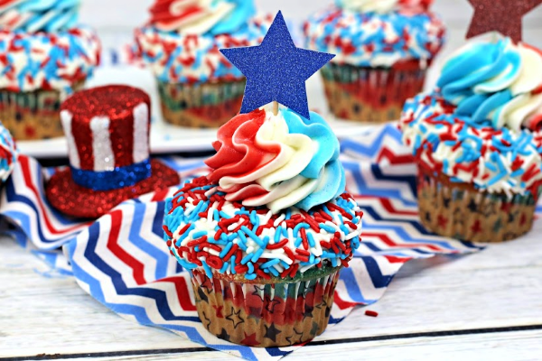 red white and blue cupcake with sprinkles